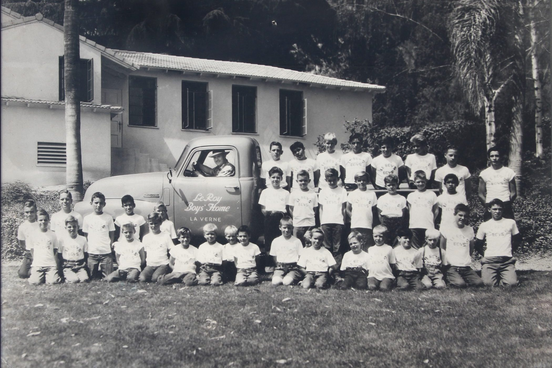 picture of rows of children next to truck