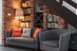 an apartment with brick walls