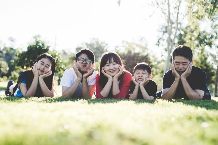 family lying down in grass