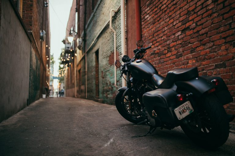 black motorcycle in alleyway