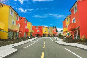 row of orange and yellow apartment buildings