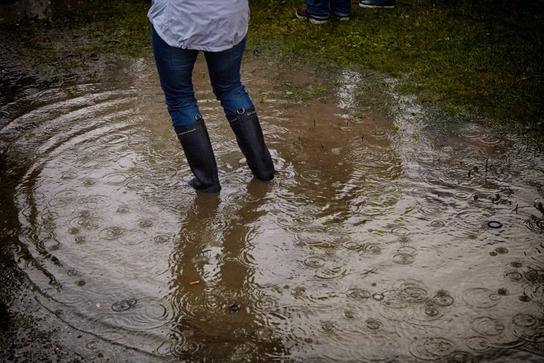 person standing in ankle deep water