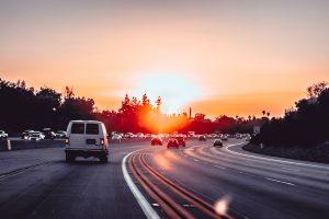 White van driving on highway